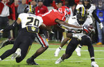 CORRECTS LOCATION TO ATHENS, INSTEAD OF ATLANTA - Georgia wide receiver George Pickens dives into the end zone between Missouri defenders Khalil Oliver, left, and Tyree Gillespie for a touchdown during the first quarter in a NCAA college football game on Saturday, Nov. 9, 2019, in Athens, Ga. (Curtis Compton/Atlanta Journal-Constitution via AP)
