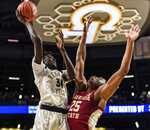 Georgia Tech forward Abdoulaye Gueye (34) attempts a shot over Florida State forward Mfiondu Kabengele (25) during the first half of an NCAA college basketball game Saturday, Feb. 16, 2019, in Atlanta. (AP Photo/Danny Karnik)