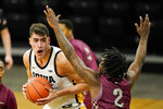 Iowa center Luka Garza, left, drives past North Carolina Central guard Justin Wright (2) during the first half of an NCAA college basketball game, Wednesday, Nov. 25, 2020, in Iowa City, Iowa. (AP Photo/Charlie Neibergall)