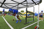 Kansas wide receiver Tanaka Scott runs a drill during NCAA college football practice, Thursday morning, Aug. 19, 2021, at the University of Kansas in Lawrence, Kan. (Evert Nelson/The Topeka Capital-Journal via AP)
