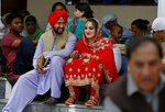 A newlywed Sikh couple attends the Vasakhi festival, at the shrine of Gurdwara Punja Sahib, the second most sacred place for Sikhs, in Hasan Abdal, some 50 kilometers (31 Miles) from Islamabad, Pakistan, Sunday, April 14, 2019. Thousands of Sikh pilgrims arrived from neighboring India and other countries to attend the harvest festival that is regionally known by many names and marks the Solar New Year. (AP Photo/Anjum Naveed)