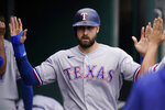 Texas Rangers designated hitter Joey Gallo is greeted in the dugout after scoring during the sixth inning of a baseball game against the Detroit Tigers, Thursday, July 22, 2021, in Detroit. (AP Photo/Carlos Osorio)