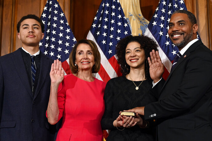 FILE - In this Jan. 3, 2019, file photo, House Speaker Nancy Pelosi of Calif., second from left, poses during a ceremonial swearing-in with Rep. Steven Horsford, D-Nev., right, on Capitol Hill in Washington. during the opening session of the 116th Congress. Horsford, the only black member of Nevada's congressional delegation, is endorsing Joe Biden for president on the eve of early voting in the state's caucuses. (AP Photo/Susan Walsh, File)