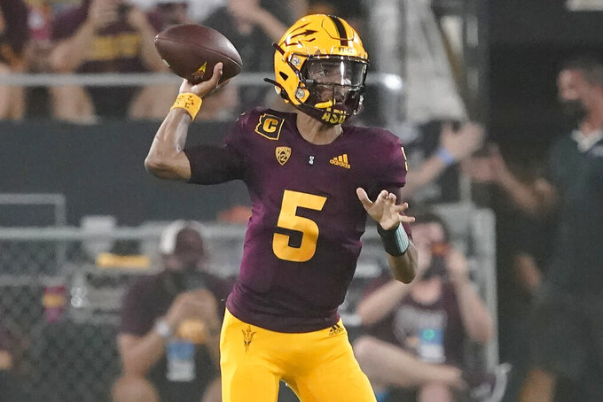 Arizona State quarterback Jayden Daniels (5) throws abasing Southern Utah during the first half of an NCAA college football game, Thursday, Sept. 2, 2021, in Tempe, Ariz. (AP Photo/Matt York)