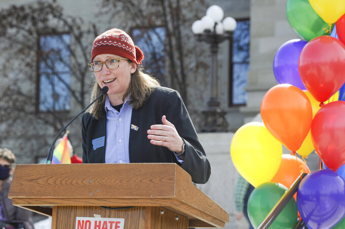 House Minority Leader Rep. Kim Abbott, D-Helena, speaks at the Rainbow Rally on the steps of the Montana State Capitol on Monday, March 15, 2021, in Helena, Mont. (Thom Bridge/Independent Record via AP)
