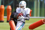 Miami Dolphins wide receiver Will Fuller (3) works a drill during NFL football practice, Wednesday, Sept. 15, 2021, in Miami Gardens, Fla. The Dolphins host the Buffalo Bills on Sunday. (David Santiago/Miami Herald via AP)