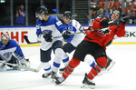 Finland's Miro Heiskanen, left, checks Canada's Ryan Nugent-Hopkins, right, during the Ice Hockey World Championships group B match between Canada and Finland at the Jyske Bank Boxen arena in Herning, Denmark, Saturday, May 12, 2018. (AP Photo/Petr David Josek)