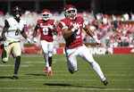 Arkansas running back Chase Hayden breaks away from the Vanderbilt defense to score a touchdown in the first half of an NCAA college football game Saturday, Oct. 27, 2018, in Fayetteville, Ark. (AP Photo/Michael Woods)