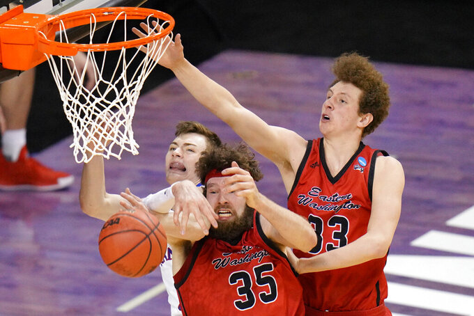 Kansas guard Christian Braun, left, battles Eastern Washington forward Tanner Groves (35) and teammate Jacob Groves (33) for a rebound during the second half of a first-round game in the NCAA college basketball tournament at Farmers Coliseum in Indianapolis, Saturday, March 20, 2021. (AP Photo/AJ Mast)