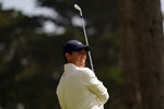 Rory McIlroy of Northern Ireland, watches his tee shot on the eighth hole during the second round of the PGA Championship golf tournament at TPC Harding Park Friday, Aug. 7, 2020, in San Francisco. (AP Photo/Jeff Chiu)