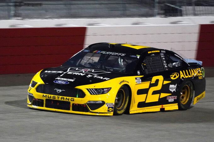Brad Keselowski drives into Turn 1 during the NASCAR Cup Series auto race Saturday, Sept. 12, 2020, in Richmond, Va. (AP Photo/Steve Helber)