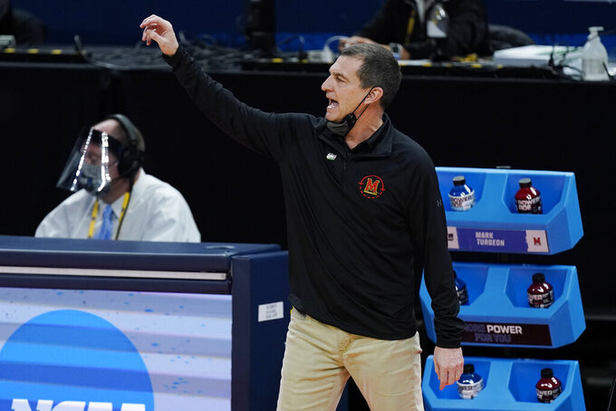 Maryland head coach Mark Turgeon directs his players during the second half of a college basketball game against Alabama in the second round of the NCAA tournament at Bankers Life Fieldhouse in Indianapolis Monday, March 22, 2021. (AP Photo/Mark Humphrey)