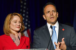 Kentucky Gov. Matt Bevin, right, and his wife, Glenna, speak to supporters gathered at a Republican Party event in Louisville, Ky., Tuesday, Nov. 5, 2019. Bevin did not concede the race to his opponent, electing to