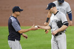New York Yankees manager Aaron Boone, left, pulls starting pitcher J.A. Happ, right, from a baseball game during the fourth inning against the Baltimore Orioles, Monday, May 20, 2019, in Baltimore. (AP Photo/Nick Wass)