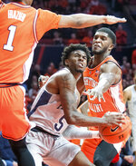 Penn State' guard Jamari Wheeler (5) looks to shoot as Illinois guard Trent Frazier (1) and Illinois forward Kipper Nichols (2) defend during the second half  of an NCAA college basketball game in Champaign, Ill., Saturday, Feb. 23, 2019.(AP Photo/Robin Scholz)