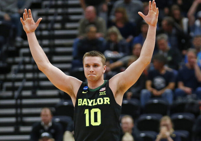 Baylor guard Makai Mason celebrates as he walks up court following a first-round game in the NCAA men's tournament, against Syracuse on Thursday, March 21, 2019, in Salt Lake City. (AP Photo/Rick Bowmer)