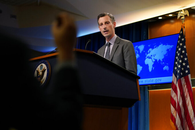 State Department spokesman Ned Price speaks to a reporter at the State Department in Washington, Wednesday, March 31, 2021. (AP Photo/Carolyn Kaster, Pool)