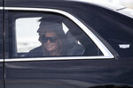 First lady Melania Trump smiles as they head to their planes at Daytona Beach International Airport, Sunday, Feb. 16, 2020, in Daytona Beach, Fla. Trump was at the NASCAR Daytona 500 auto race at Daytona International Speedway. (AP Photo/Alex Brandon)