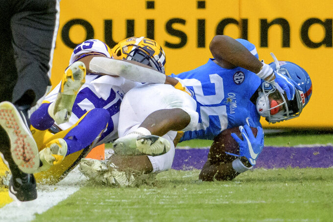 Mississippi running back Henry Parrish Jr. (25) is just short of a touchdown against LSU cornerback Cordale Flott (25) during the first half of an NCAA college football game in Baton Rouge, La., Saturday, Dec. 19, 2020. (AP Photo/Matthew Hinton)