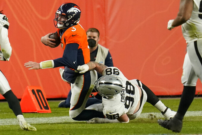 Las Vegas Raiders defensive end Maxx Crosby (98) sacks Denver Broncos quarterback Drew Lock (3) during the second half of an NFL football game, Sunday, Jan. 3, 2021, in Denver. (AP Photo/Jack Dempsey)