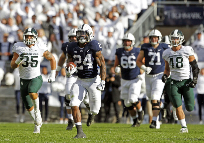 Penn State's Miles sanders (24) breaks off a long run against Michigan State during the first half of an NCAA college football game in State College, Pa., Saturday, Oct. 13, 2018. (AP Photo/Chris Knight)