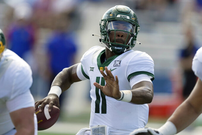 Baylor quarterback Gerry Bohanon (11) looks for a receiver during the first half of an NCAA college football game against Kansas in Lawrence, Kan., Saturday, Sept. 18 2021. (AP Photo/Orlin Wagner)