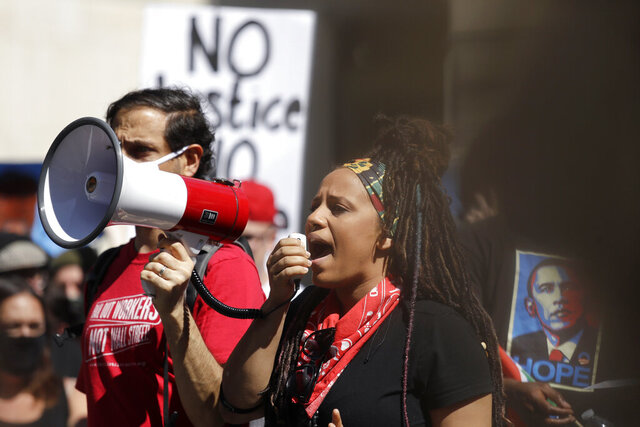 Demonstrator Rashyla Levitt speaks as a protest begins Monday, June 1, 2020, in Seattle, following protests over the weekend over the death of George Floyd, a black man who died after being restrained by Minneapolis police officers on May 25. (AP Photo/Elaine Thompson)