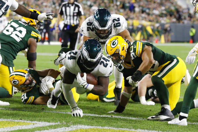 Philadelphia Eagles running back Jordan Howard rushes for a touchdown during the second half of the team's NFL football game against the Green Bay Packers on Thursday, Sept. 26, 2019, in Green Bay, Wis. (AP Photo/Mike Roemer)