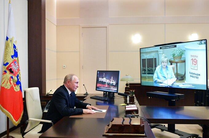 Russian President Vladimir Putin speaks to Ella Pamfilova, head of Russian Central Election Commission, on the screen, during their meeting via video conference at the Novo-Ogaryovo residence outside Moscow, Russia, Monday, Sept. 20, 2021. (Alexei Druzhinin, Sputnik, Kremlin Pool Photo via AP)