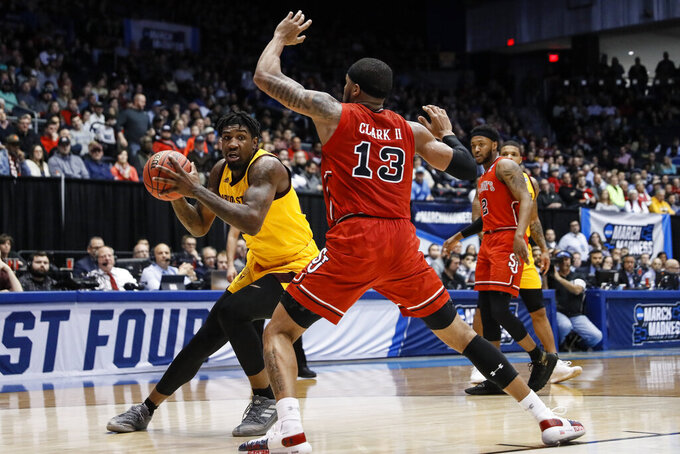 Arizona State's Romello White, left, looks to pass the ball around St. John's Marvin Clark II (13) during the first half of a First Four game of the NCAA men's college basketball tournament Wednesday, March 20, 2019, in Dayton, Ohio. (AP Photo/John Minchillo)