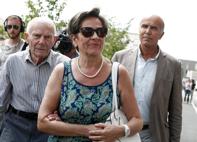 FILE - In this July 23, 2015 file photo, Viviane and Pierre Lambert, left, parents of Vincent Lambert, arrive at the Sebastopol hospital, in Reims, eastern France, where Vincent, who is currently on artificial life support, is hospitalized. A last-ditch appeal to the United Nations forced French doctors to resume life support for a man who has been in a vegetative state for years and whose case has drawn attention across Europe. (AP Photo/Thibault Camus, File)