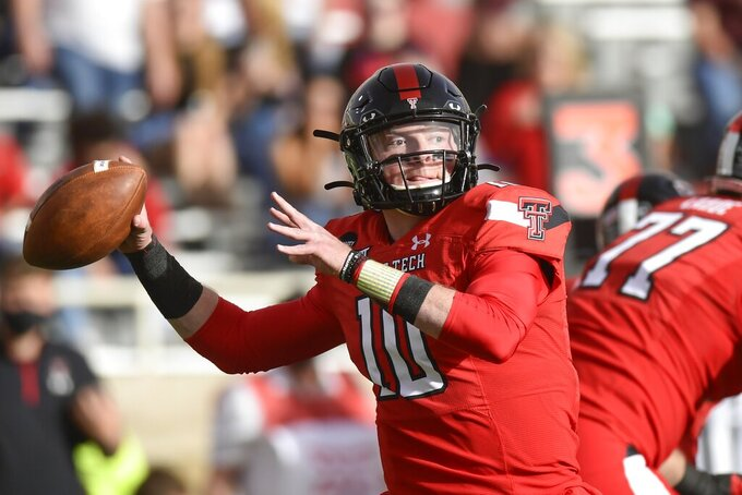 Texas Tech quarterback Alan Bowman (10) looks to throw against Baylor during an NCAA college football game in Lubbock, Texas, Saturday, Nov. 14, 2020. (AP Photo/Justin Rex)