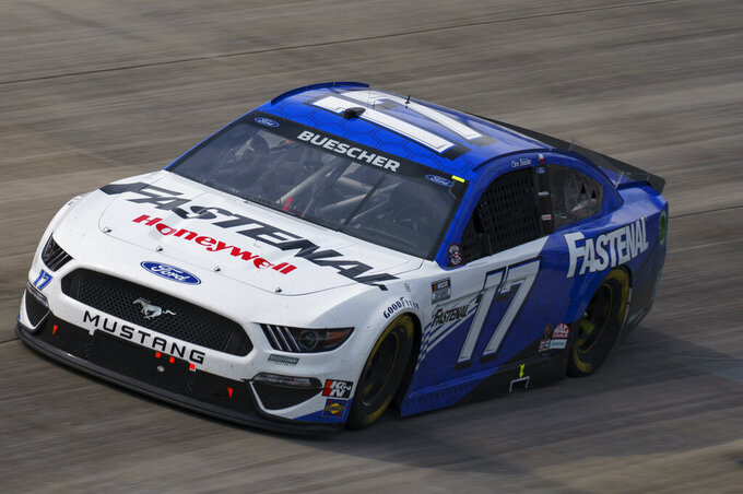 FILE - Chris Buescher drives during a NASCAR Cup Series auto race at Dover International Speedway in Dover, Del., in this, Sunday, May 16, 2021, file photo. Roush Fenway Racing on Wednesday, May 19, 2021, announced a contract extension with both driver Chris Buescher and longtime sponsor Fastenal. The deal with Fastenal was extended through the 2024 season. (AP Photo/Chris Szagola, File)