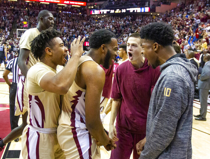 Florida State players celebrate tying the game at the end of the first half of an NCAA college basketball game against Duke in Tallahassee, Fla., Saturday, Jan. 12, 2019. (AP Photo/Mark Wallheiser)
