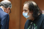 Adult film star Ron Jeremy, right, makes his first appearance in downtown Los Angeles Criminal Court on Tuesday, June 23, 2020. Los Angeles County prosecutors say Jeremy has been charged with raping three women and sexually assaulting a fourth. (Robert Gauthier/Los Angeles Times via AP, Pool)