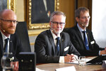 Goran K Hansson, Secretary General of the Royal Swedish Academy of Sciences, center, and academy members Peter Fredriksson, left, and Jakob Svensson announce the winners of the 2019 Nobel Prize in Economics during a news conference at the Royal Swedish Academy of Sciences in Stockholm, Sweden, Monday Oct. 14, 2019. The Nobel prize in economics has been awarded to Abhijit Banerjee, Esther Duflo and Michael Kremer