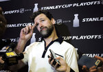 FILE - In this Wednesday, May 8, 2019, file photo, Carolina Hurricanes' Justin Williams talks with reporters during an NHL hockey media availability in Boston. Paying the bills, going out to dinner and cutting the grass can fall by the wayside for NHL players on long playoff runs. Williams loses track of what day it is: It's either a game day or not a game day, though doing a daily newspaper crossword puzzle reminds him that it's actually, say, Saturday. (AP Photo/Steven Senne, File)