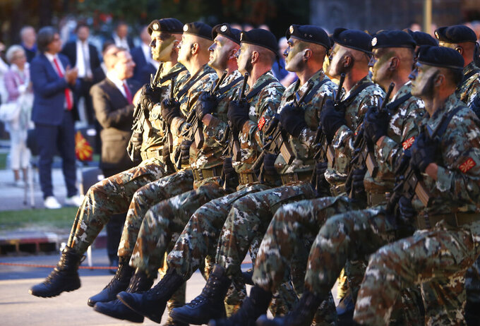 Army soldiers march during a parade to mark the Independence Day in downtown Skopje, North Macedonia, Wednesday, Sept. 8, 2021. North Macedonia is celebrating Wednesday the 30th anniversary since its independence from former Yugoslavia. (AP Photo/Boris Grdanoski)