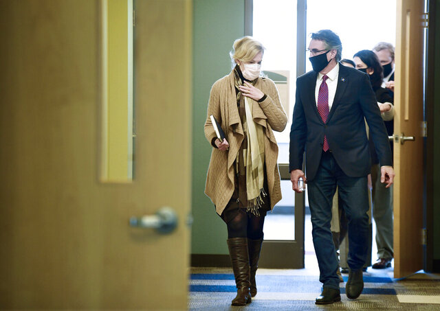 Dr. Deborah Birx, White House Coronavirus Response Coordinator, walks with Gov. Doug Burgum after holding a roundtable discussion with state and local government and medical leaders on the campus of Bismarck State College on Monday, Oct. 26, 2020. (Mike McCleary/The Bismarck Tribune via AP)