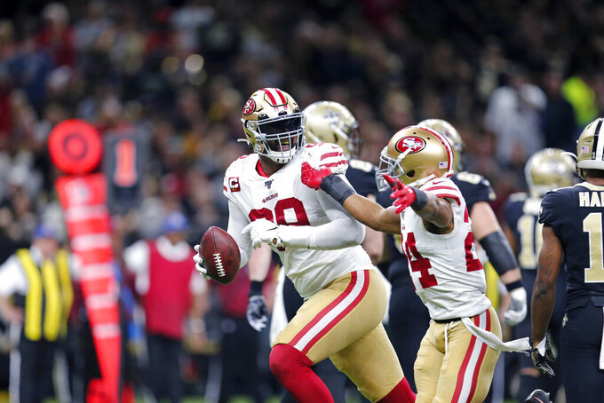 San Francisco 49ers defensive tackle DeForest Buckner (99) celebrates his fumble recovery with defensive back K'Waun Williams (24) in the second half an NFL football game against the New Orleans Saints in New Orleans, Sunday, Dec. 8, 2019. (AP Photo/Brett Duke)