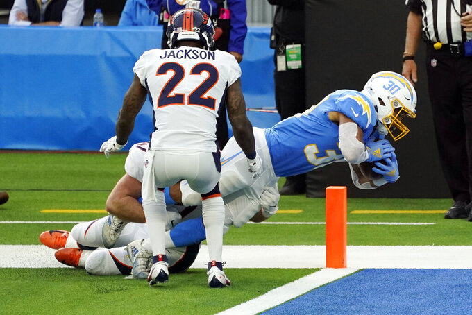 Los Angeles Chargers running back Austin Ekeler (30) scores a touchdown against the Denver Broncos during the first half of an NFL football game Sunday, Dec. 27, 2020, in Inglewood, Calif. (AP Photo/Ashley Landis)