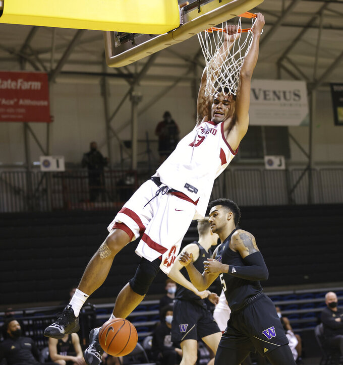 CORRECTS YEAR TO 2021 NOT 2020 - Stanford forward Oscar da Silva (13) dunks against Washington guard Jamal Bey (5) during the first half of an NCAA college basketball game in Santa Cruz, Calif., Thursday, Jan. 7, 2021. (AP Photo/Josie Lepe)