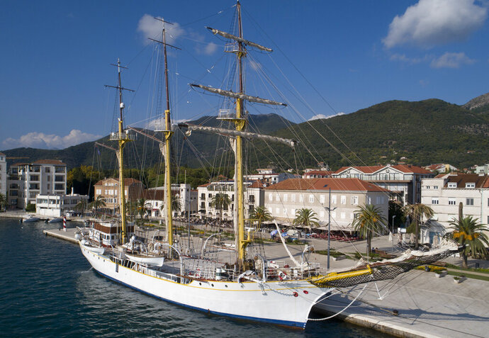 FILE - In this Sept. 6, 2018 file photo, the training vessel 'Jadran' is moored at the port of Tivat, Montenegro. Montenegrin defense ministry says the army has discovered drugs hidden on a military training ship ahead of its planned journey to Turkey and Greece. The ministry says that military police early on Friday, April 19, 2019 searched the ship called 'Jadran', or the Adriatic, after learning that certain criminal gangs were planning to use it to smuggle drugs. (AP Photo/Darko Bandic, File)