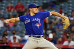 Toronto Blue Jays starting pitcher Ross Stripling throws to a Los Angeles Angels batter during the first inning in the second baseball game of a doubleheader Tuesday, Aug. 10, 2021, in Anaheim, Calif. (AP Photo/Marcio Jose Sanchez)