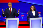 Democratic presidential candidate Sen. Cory Booker, D-N.J., left, speaks as Sen. Kamala Harris, D-Calif., listens during a Democratic presidential primary debate hosted by CNN/New York Times at Otterbein University, Tuesday, Oct. 15, 2019, in Westerville, Ohio. (AP Photo/John Minchillo)