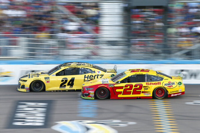 William Byron (24) and Joey Logano (22) race side-by-side during the NASCAR Cup Series auto race at ISM Raceway, Sunday, Nov. 10, 2019, in Avondale, Ariz. (AP Photo/Ralph Freso)