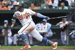 Baltimore Orioles' Hanser Alberto follows through on a RBI single against the Boston Red Sox in the eighth inning of a baseball game Sunday, June 16, 2019, in Baltimore. The Red Sox won 8-6 in 10 innings. (AP Photo/Gail Burton)