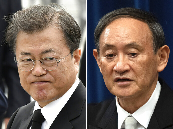FILE - This combination of file photos show South Korean President Moon Jae-in, left, taken in Gwangju on May 18, 2020, and Japanese Prime Minister Yoshihide Suga, right, taken in Tokyo on Sept. 16, 2020.  Suga on Thursday, Sept. 24, held his first telephone call with his South Korean counterpart since taking office, telling President Moon that the neighbors should work to resolve their strained relations. (AP Photo/File)