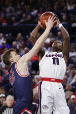 Gonzaga guard Joel Ayayi (11) shoots over Saint Mary's guard Kristers Zoriks (23) during the first half of an NCAA college basketball game in Spokane, Wash., Saturday, Feb. 29, 2020. (AP Photo/Young Kwak)