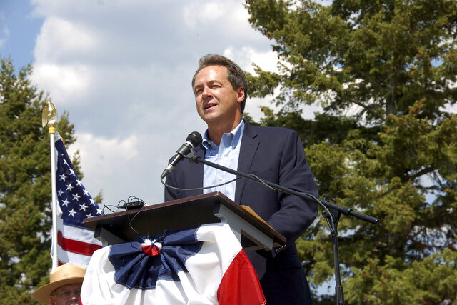 In this Aug. 17, 2017 file photo, Montana Gov. Steve Bullock speaks at an event marking a conservation agreement at a former mining site in Jardine, Mont. Steve Bullock never got to square off directly against President Donald Trump before dropping out of the Democratic presidential primary race last year. But the two-term governor is getting another chance on his home turf by trying to oust a strong Trump ally, first-term Republican Sen. Steve Daines in Montana's U.S. Senate race. (AP Photo/Matthew Brown)